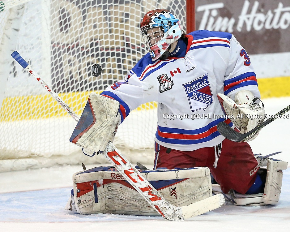 Oakville, ON - MAR 4, 2016  Ontario Junior Hockey League game action between St. Michael's and Oakville Blades at the Sixteen Mile Sports Complex Oakville, ON. Brendan Mcglynn #34 of the Oakville Blades makes a blocker save during the third period. <br /> (Photo by Kevin Sousa / OJHL Images)