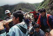 Peru over the Andes snakes down into the lowland jungles near the Alta Urubamba River in Peru. The road was traveled during the rainy season and there were many washouts and landslides. Villagers travel in the back of large trucks that serve as busses. Image from the book project Man Eating Bugs: The Art and Science of Eating Insects.