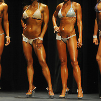 Heidi LaFrenz (left to right) Kimberly Wurpts, Britanie Ferden and Madeleine Whalen pose while being judged in the bikini competition during the Mr. and Ms. Sioux Empire Natural Bodybuilding and Figure Championships at the Orpheum Theater.