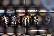 Pedestrians in Nogales, Sonora, Mexico, wait to cross in to Arizona at the U.S. Customs and Border Protection, Morley Gate Border Station, as seen through the border wall in Nogales, Arizona, USA.