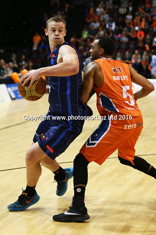 Finn Delany of the Giants (L)  and Everard Bartlett of the Sharks contest the ball in the NBL basketball match between the Southland Sharks and Nelson Giants, ILT Stadium Southland, Invercargill, Saturday, March 12, 2016. Photo: Dianne Manson / www.photosport.nz