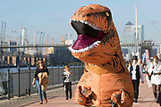UNITED KINGDOM, London: 27 October 2017 A cosplay fan dressed as an inflatable Tyrannosaurus Rex makes his way to the MCM London Comic Con. The convention, which runs all this weekend at the Excel Centre, will see thousands of cosplay and comic book fans visit the venue. Rick Findler / Story Picture Agency