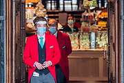 Fortnum and Masons opens with messages of thanks to the NHS and a visor and mask for its re coated doorman - The 'lockdown' continues for the Coronavirus (Covid 19) outbreak in London.