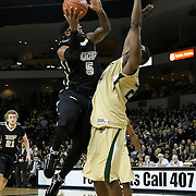 Central Florida guard Marcus Jordan (5) shoots against Augustus Gilchrist (24) during the NCAA basketball game against the USF Bulls at the UCF Arena on November 18, 2010 in Orlando, Florida. UCF won the game 65-59. (AP Photo/Alex Menendez)