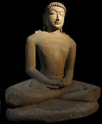 Tirthankar seated first half of the 11th century. In Jainism, a Tirthankar 'Fordmaker or Propagator' or Jina, is a human being who achieves enlightenment (perfect knowledge) through asceticism and who then becomes a role-model teacher for those seeking spiritual guidance.