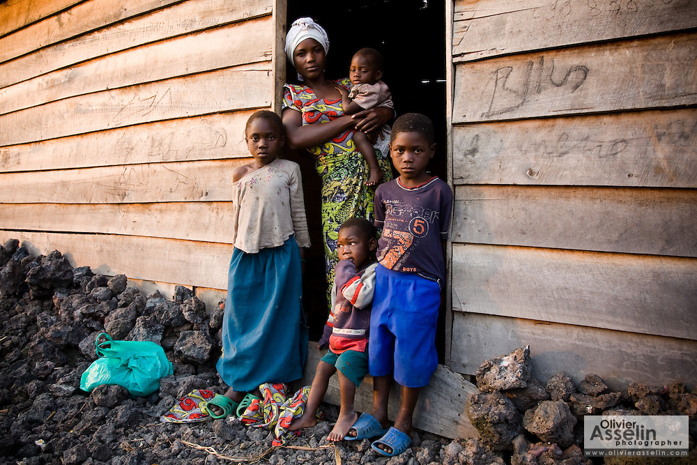 Jeanine Kahindo, 28, and her children in the Majengo neighborhood in Goma, Eastern Democratic Republic of Congo on Saturday December 20, 2008. Originally from Kikumba, she fled six weeks ago when violence broke out, her brother in law killed during his sleep. Her husband and herself pay 5$ to rent a small house in Goma where they live with their children. A few days ago, she says, soldiers looted the neighbors' home in broad daylight, taking radios, cookware, matresses, everything.