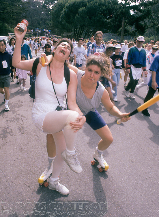 Two women spoofing Olympic figure skaters Nancy Kerrigan, left, and Tonya Harding clown for the camera at the 83rd running of the Bay to Breakers 12K race, Sunday, May 15, 1994 in San Francisco. (Photo by D. Ross Cameron)