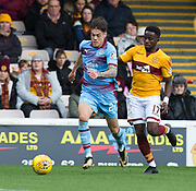 3rd November 2018, Fir Park, Motherwell, Scotland; Ladbrokes Premiership football, Motherwell versus Dundee; Jesse Curran of Dundee races away from Gael Bigirimana of Motherwell