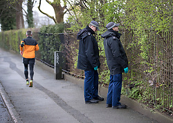 © Licensed to London News Pictures. 02/04/2018. London, UK. A jogger runs past as a police search team visually check bushes near Ellerton Road in Wandsworth, south west London where 20 year old Devoy Stapleton was stabbed to death at 1am on Sunday 1st April - the 31st fatal stabbing this year in the capital. It is being reported that London's murder rate has overtaken New York's.   Photo credit: Peter Macdiarmid/LNP