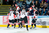 KELOWNA, CANADA, OCTOBER 26: The Prince George Cougars celebrate a goal as the  Prince George Cougars visit the Kelowna Rockets  on October 26, 2011 at Prospera Place in Kelowna, British Columbia, Canada (Photo by Marissa Baecker/Shoot the Breeze) *** Local Caption ***
