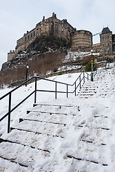 View of Edinburgh Castle from snow covered Granny's Green Steps in Grassmarket, Edinburgh, Scotland, United Kingdom
