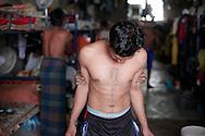 10/10/2014 -- Kirkuk, Iraq -- Bangladeshi workers joke during their break in the afternoon.