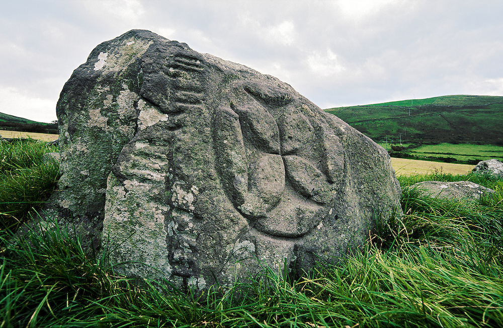 Cross of arcs and ogham writing. Early Celtic Christian stone. Maumanorig enclosure at Kilcolman near Ventry, Co. Kerry, Ireland