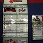 Starting line ups and division tables on the wall at New Britain Stadium during the New Britain Rock Cats Vs Binghamton Mets Minor League Baseball game at New Britain Stadium, New Britain, Connecticut, USA. 2nd July 2014. Photo Tim Clayton