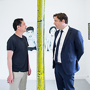 "11.06.2017         <br /> International award winning artists are among the almost 200 graduates of Limerick School of Art and Design who's work went on exhibition at the LSAD Graduate Show 2017.<br /> <br /> Pictured is 4th year graduating Painting  student, Gary Kin-San Chan discussing his work titled 'The Binary Oppositions and The Myth of Sisyphus' with John Concannon, Director of Creative Ireland who officially opened the show.<br />  <br /> Students from the college took control of the over-riding message of this historical show as they conceptualised, designed and delivered on the theme - be.cause.<br />  <br /> The hypothesis conceived by Graphic Design graduates Cassandra Walsh and David Reilly, is derived from the fact the graduates have now reached a stage where they are confident with their work, their interpretations and creative solutions. As creative minds they have an innate need to ""do"" something. There is just this need to create, be.cause.<br /> . Picture: Alan Place."