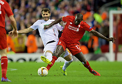 LIVERPOOL, ENGLAND - Thursday, February 25, 2016: Liverpool's Mamadou Sakho in action against FC Augsburg's Halil Altıntop during the UEFA Europa League Round of 32 1st Leg match at Anfield. (Pic by David Rawcliffe/Propaganda)