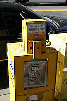 Newspaper vending machine with the New York Post showing the headline Steve Jobs Dead