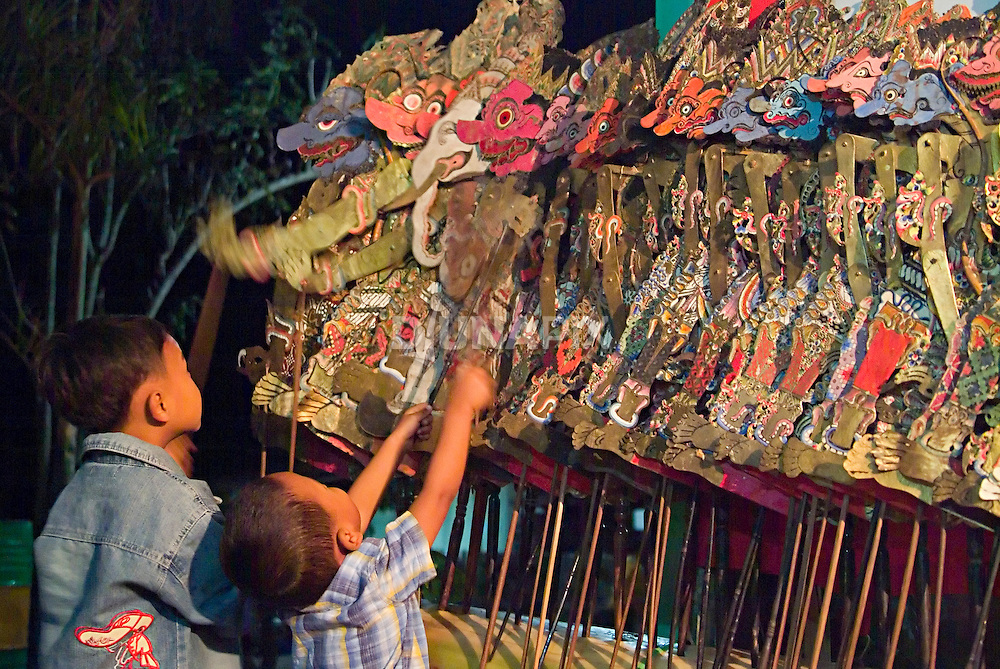 Children at a Merapi refugee camp play with Javanese shadow puppets before a 'wayang kulit' performance. The puppets in this collection, on loan from the Yogyakarta sultan's royal palace, number in the hundreds. Delicately carved on water buffalo hide, painted with traditional pigments and layered with gold leaf, the puppets have stood up well to vigorous performances--and curious kids--for over a hundred years.
