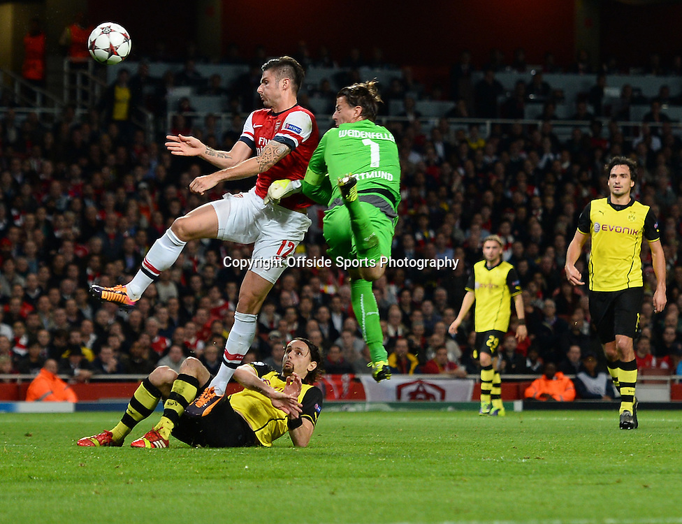 21st October 2013 - UEFA Champions League Group F - Arsenal v Borussia Dortmund - Olivier Giroud of Arsenal scores the equalising goal after a mix up between Roman Weidenfeller and Neven Subotic of Borussia Dortmund- Photo: Marc Atkins / Offside.