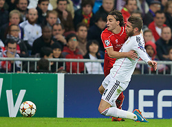 MADRID, SPAIN - Tuesday, November 4, 2014: Liverpool's Lazar Markovic in action against Real Madrid's Sergio Ramos during the UEFA Champions League Group B match at the Estadio Santiago Bernabeu. (Pic by David Rawcliffe/Propaganda)