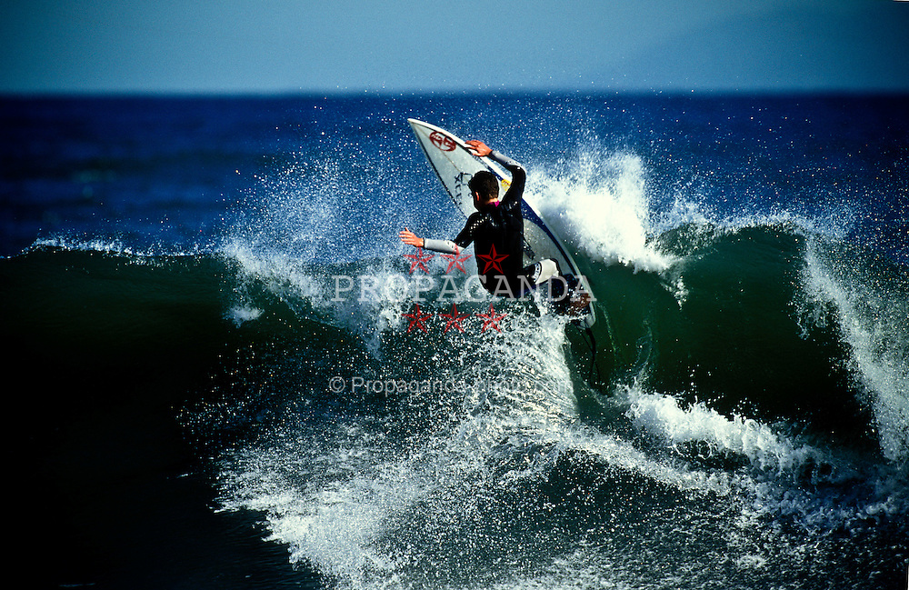 A surfer smacks the lip of a wave off the coast of Huntington Beach, Califronia, EXPA Pictures © 2010, PhotoCredit: EXPA/ New Sport/ Les Walker *** ATTENTION *** United States of America OUT!
