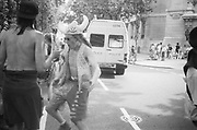 Ravers dancing in the street, 2nd Criminal Justice March, Victoria, London, UK, 23rd of July 1994.