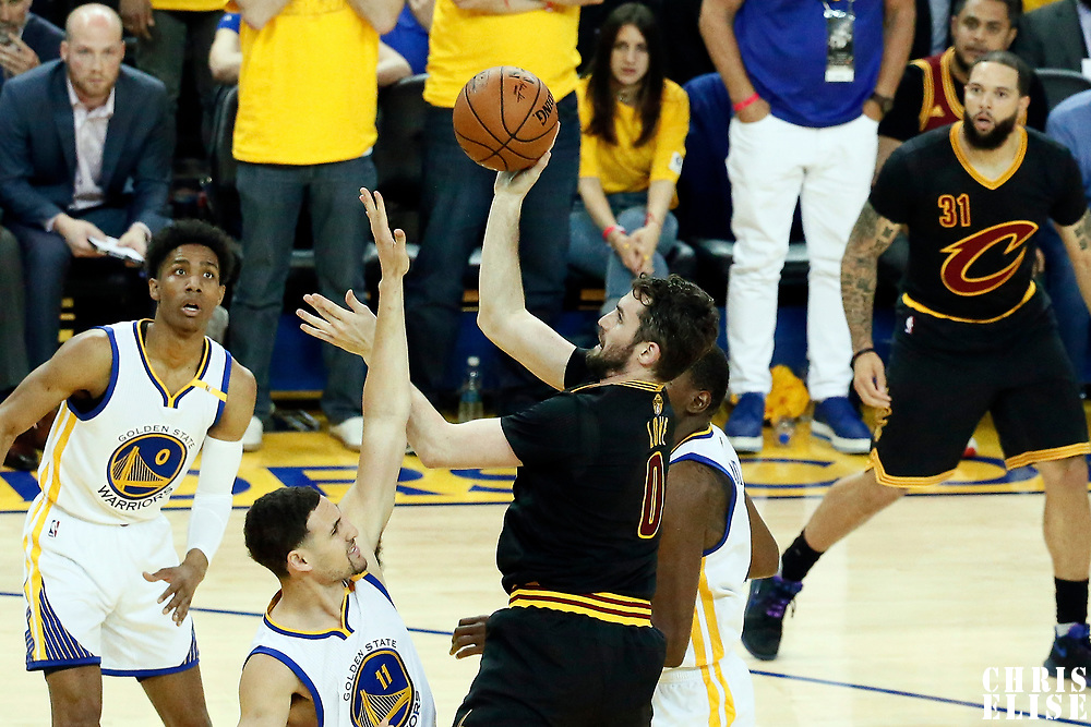 12 June 2017: Cleveland Cavaliers forward Kevin Love (0) goes for the jump shot over Golden State Warriors guard Klay Thompson (11) during the Golden State Warriors 129-120 victory over the Cleveland Cavaliers, in game 5 of the 2017 NBA Finals, at the Oracle Arena, Oakland, California, USA.