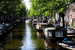 Amsterdam is the largest city and the capital of the Netherlands.  Amsterdam has a population of 783,364 within city limits, an urban population of 1,209,419 and a metropolitan population of 2,158,592.  The city is in the province of North Holland in the west of the country. It comprises the northern part of the Randstad, one of the larger conurbations in Europe, with a population of approximately 7 million..Its name is derived from Amstelredamme,[9] indicative of the city's origin: a dam in the river Amstel. Settled as a small fishing village in the late 12th century, Amsterdam became one of the most important ports in the world during the Dutch Golden Age, a result of its innovative developments in trade. During that time, the city was the leading center for finance and diamonds.[10] In the 19th and 20th centuries, the city expanded, and many new neighborhoods and suburbs were formed. The 17th-century canals of Amsterdam (in Dutch: 'Grachtengordel'), located in the heart of Amsterdam, were added to the UNESCO World Heritage List in July 2010.