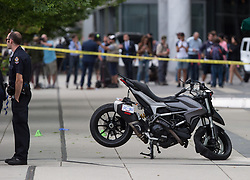 "A police officer stands by a motorcycle that was righted after a female stunt driver working on the movie ""Deadpool 2"" died after a crash on set, in Vancouver, BC, Canada, on Monday August 14, 2017. Vancouver police say the driver was on a motorcycle when the crash occurred on the movie set on Monday morning. Photo by Darryl Dyck/CP/ABACAPRESS.COM"