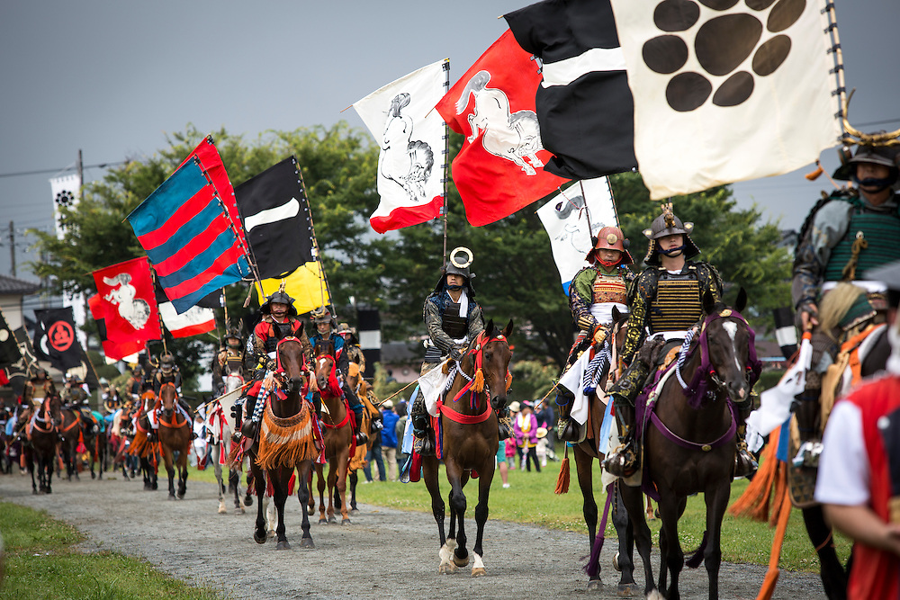"""MINAMISOMA, JAPAN - JULY 24 :  A samurai horsemen is seen parade during the """"Hon Matsuri"""", Soma Nomaoi festival at Hibarigahara field on Sunday, July 24, 2016 in Minamisoma, Fukushima Prefecture, Japan. """"Soma-Nomaoi"""" is a three day traditional festival that recreates a samurai battle scene from more than 1,000 years ago. The festival has gathered more than thousands visitors as Fukushima still continues to recovery from the 2011 nuclear disaster, the samurai warriors battles for recovery of the area. (Photo: Richard Atrero de Guzman/NURPhoto)"""