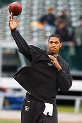 December 19, 2010; Oakland, CA, USA;  Oakland Raiders quarterback Jason Campbell (8) warms up before the game against the Denver Broncos at Oakland-Alameda County Coliseum.