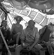 People hanging out inside makeshift tent, Glastonbury, Somerset, 1989