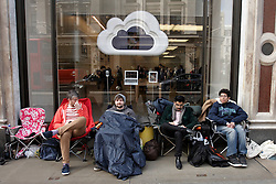 © Licensed to London News Pictures.  14/03/2012. LONDON, UK. Fans queue outside the flagship Apple store in Regent Street London ahead of the Friday (16 March)  launch of the new iPad 3. First in the queue Zohaib Ali (pictured right), 21, a pharmacy worker from Uxbridge, started queuing at 1pm on Saturday, six days before the product goes on sale. In this photo right to left, Zonhaib Ali (21). Vik Rathor (25), Mike Roberts (22), Craig Fox (30).  Photo credit :  Cliff Hide/LNP