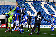 Colchester United goalkeeper Rene Gilmartin (25) punches the ball  clear during the EFL Sky Bet League 2 match between Colchester United and Lincoln City at the JobServe Community Stadium, Colchester, England on 27 October 2018.