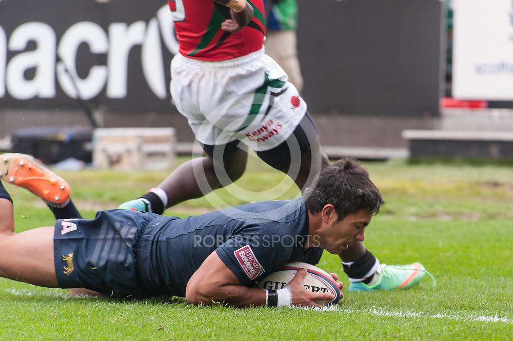 An Argentina player dives over for a try against Kenya. Action from the IRB Emirates Airline Glasgow 7s at Scotstoun in Glasgow. 3 May 2014. (c) Paul J Roberts / Sportpix.org.uk