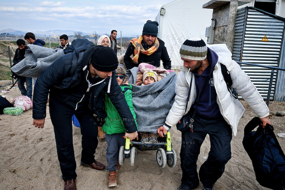 A group of Syrian refugees is  preparing to cross the Greek-Macedonian border at the village of Idomeni, Greece,8 Febraury 2016.<br /> Hundreds of refugees arrive at Idomeni and cross the border between Greece and Macedonian on their journey to North Europe.