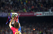 Carlos Puyol celebrates with the La Liga trophy. Barcelona v Osasuna (0-1), La Liga, Nou Camp, Barcelona, 23rd May 2009.