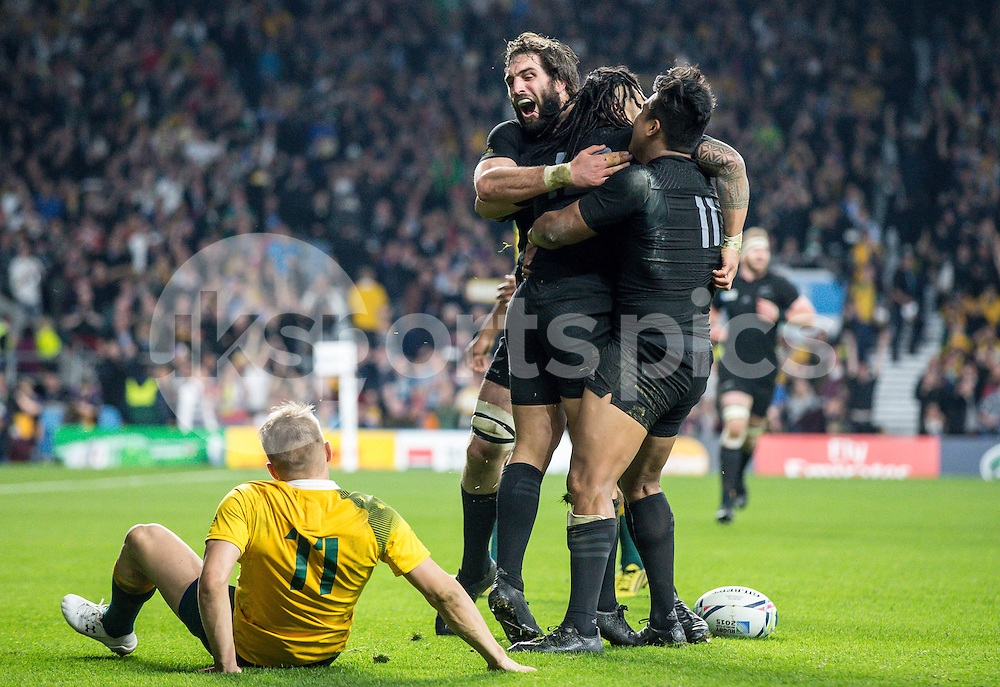 Ma'a Nonu of New Zealand celebrates scoring his try with teammates Julian Savea of New Zealand and Samuel Whitelock of New Zealand during the Rugby World Cup Final match between New Zealand and Australia played at Twickenham Stadium, London on the 31st of October 2015. Photo by Liam McAvoy