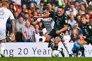 Leeds United midfielder Jack Harrison (22) fouls Swansea City defender Connor Roberts (23) during the EFL Sky Bet Championship match between Leeds United and Swansea City at Elland Road, Leeds, England on 31 August 2019.