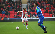 Stoke City midfielder Joe Allen (4) strides forward  during the EFL Sky Bet Championship match between Stoke City and Wigan Athletic at the Bet365 Stadium, Stoke-on-Trent, England on 23 November 2019.