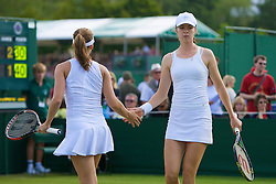 LONDON, ENGLAND - Wednesday, June 25, 2008: Galina Voskoboeva (RUS) and Ashley Harkleroad (USA) during their first round doubles match on day three of the Wimbledon Lawn Tennis Championships at the All England Lawn Tennis and Croquet Club. (Photo by David Rawcliffe/Propaganda)