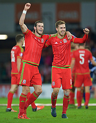 CARDIFF, WALES - Tuesday, October 13, 2015: Wales' Gareth Bale and Aaron Ramsey celebrate qualifying for the finals following a 2-0 victory over Andorra during the UEFA Euro 2016 qualifying Group B match at the Cardiff City Stadium. (Pic by Ian Cook/Propaganda)