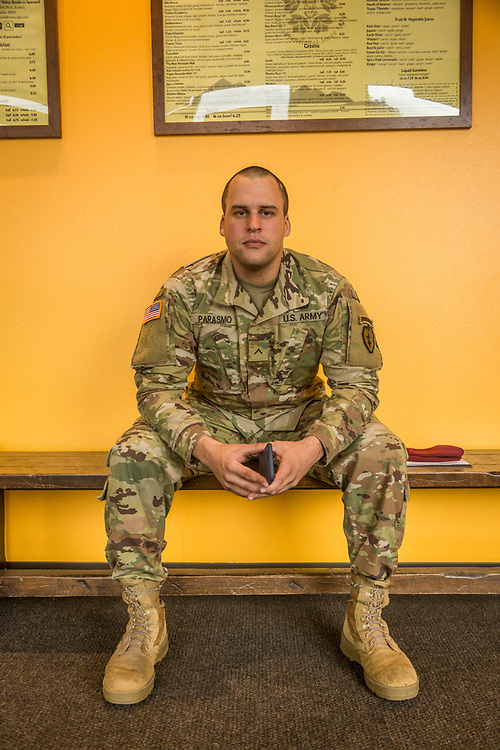 """""""I'm six months in the Army, one month in Alaska and I have six jumps under my belt.""""  -PV-2 Army 19 Delta Cavalry Scout Marcelo Parasmo awaits friends at Middle Way Cafe in Anchorage, Alaska."""
