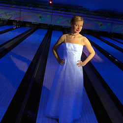 Extreme bowling is a popular activity for many prom-goers in their evening wear before and after the dance. <br /> (Christina Paolucci, photographer).