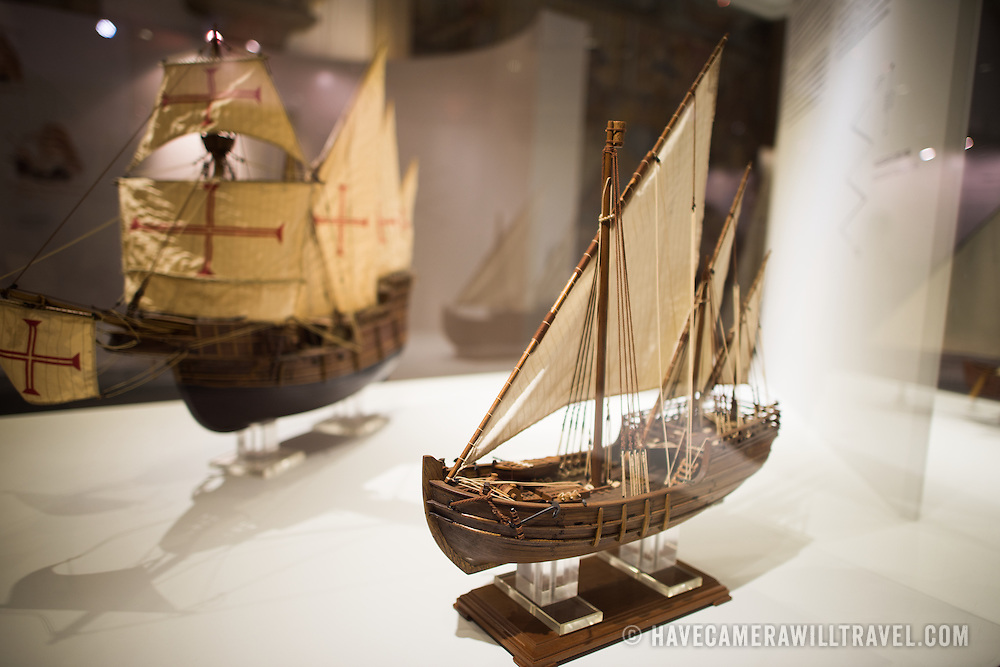 In the foreground is a model of a 3 Masts Lateen Rigged Caravel from the late-15th century. In the background, at left, is a model of a Square-Rgged Caravel from the early 16th century. The Museu de Marinha (Maritime Museum of Navy Museum) focuses on Portuguese maritime history. It features exhibits on Portugal's Age of Discovery, the Portuguese Navy, commercial and recreational shipping, and, in a large annex, barges and seaplanes. Located in the Belem neighborhood of Lisbon, it occupies, in part, one wing of the Jerónimos Monastery. Its entrance is through a chapel that Henry the Navigator had built as the place where departing voyagers took mass before setting sail. The museum has occupied its present space since 1963.