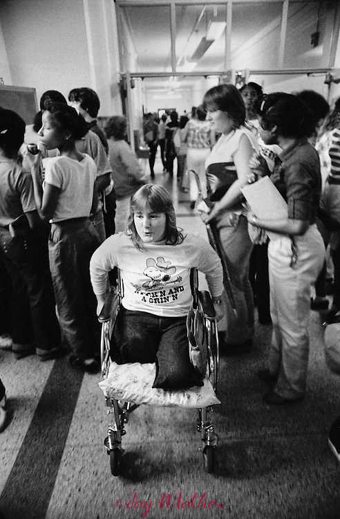 March, 1981.  Malinda Lamb at 16 was attempting to follow her boyfriend between two moving freight cars in the railyards in Louisville, Kentucky.  She fell and the wheels of the car crushed her legs.  She survived and so began a long rehabilitation to regain her mobility.  I, along with fellow journalist, Ellie Brecher, documented her recovery from the first days in the hospital in 1981 through her high school graduation.  A selection of these photographs were awarded the 1981 Robert F. Kennedy Award in Photojournalism for coverage of the disadvantaged.