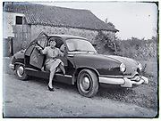 vintage image of woman posing with a Packard car 1950s France