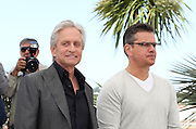 "Michael Douglas (L) & Matt Damon attend ""Behind The Candelabra"" photo call  during the 66th Annual Cannes Film Festival at the Palais des Festivals on May 21, 2013 in Cannes, France.."