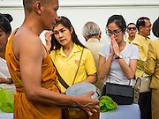 09 JUNE 2016 - BANGKOK, THAILAND: A woman bows her head in prayer after presenting alms to a monk at a special merit making ceremony at the Grand Palace. Thailand marked 70 years of the reign of Bhumibol Adulyadej, the King of Thailand, with a special alms giving ceremony for 770 monks in front of the Grand Palace in Bangkok. The King, also known as Rama IX, ascended the throne on 9 June 1946. He is the longest serving monarch in Thai history and the longest serving monarch in the world today. He is revered by most Thais and is widely seen as a unifying figure in the country.      PHOTO BY JACK KURTZ