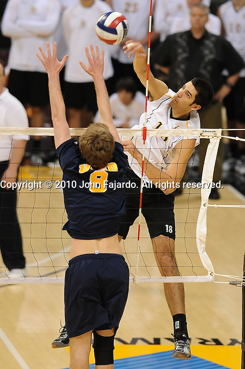 Dean Bittner(R) hits above the block of Phil Bannan(8) in the match against U.C. San Diego at the Walter Pyramid, Long Beach CA, Friday, Jan. 29, 2010.  The 49ers win in three straight sets, 30-22, 30-22, 30-21.